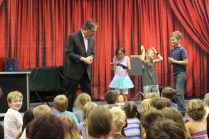 Kids at magic show